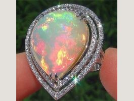 18 caratBague princesse Opal fire d 1.-